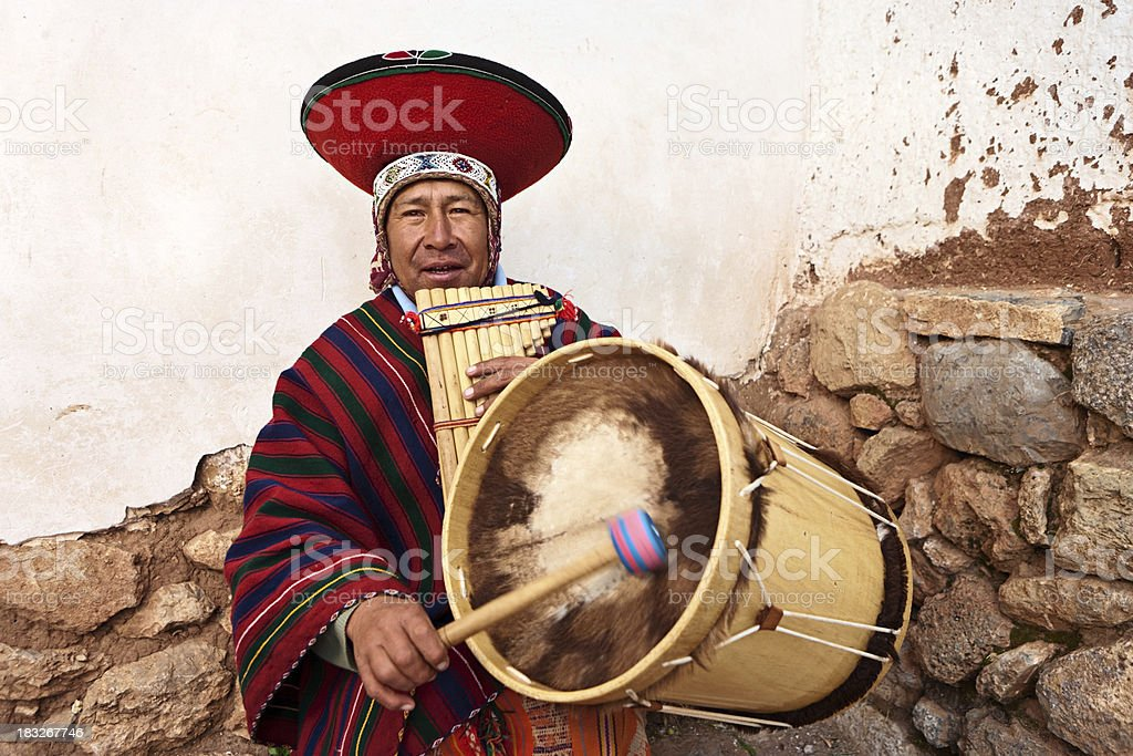 Peruvian man playing a panflute and drums, Sacred Valley royalty-free stock photo