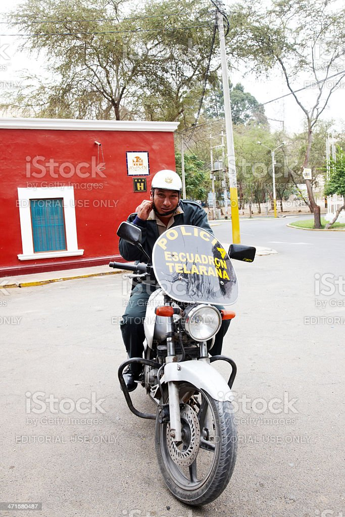 Peruvian motorcycle policeman on duty in Huacachina royalty-free stock photo
