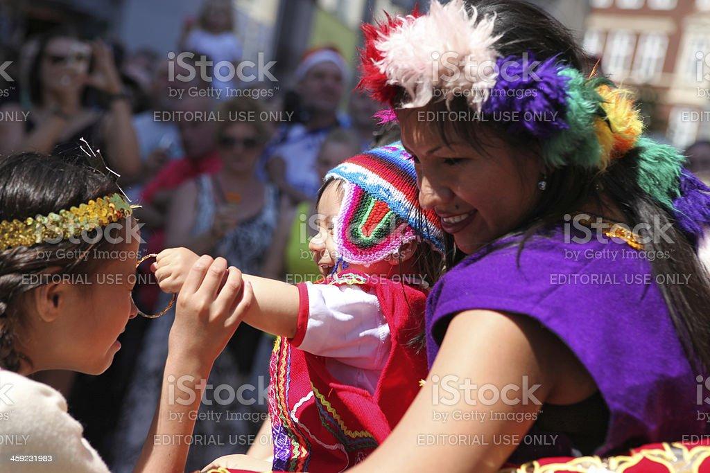 Peruvian woman and children in carnival parade, Copenhagen Denmark royalty-free stock photo