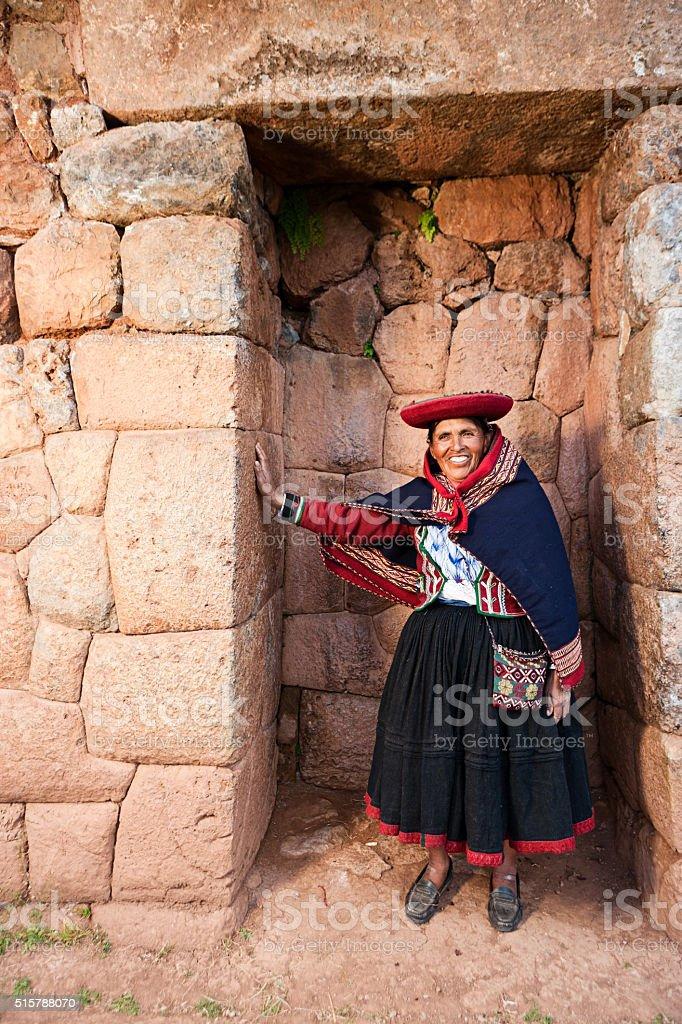 Peruvian woman at Inca ruins in Sacred Valley, Peru stock photo