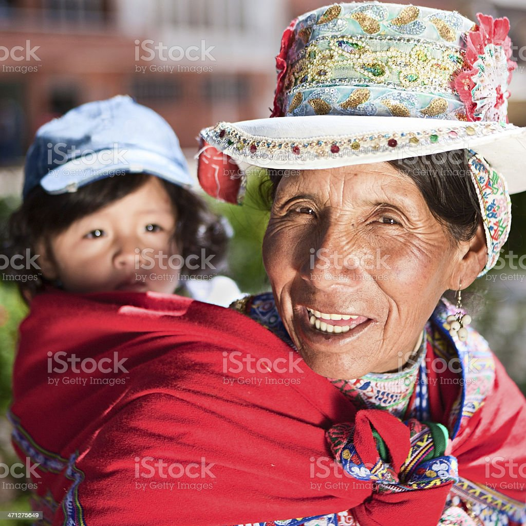 Peruvian woman in national clothing carrying her baby, Chivay royalty-free stock photo
