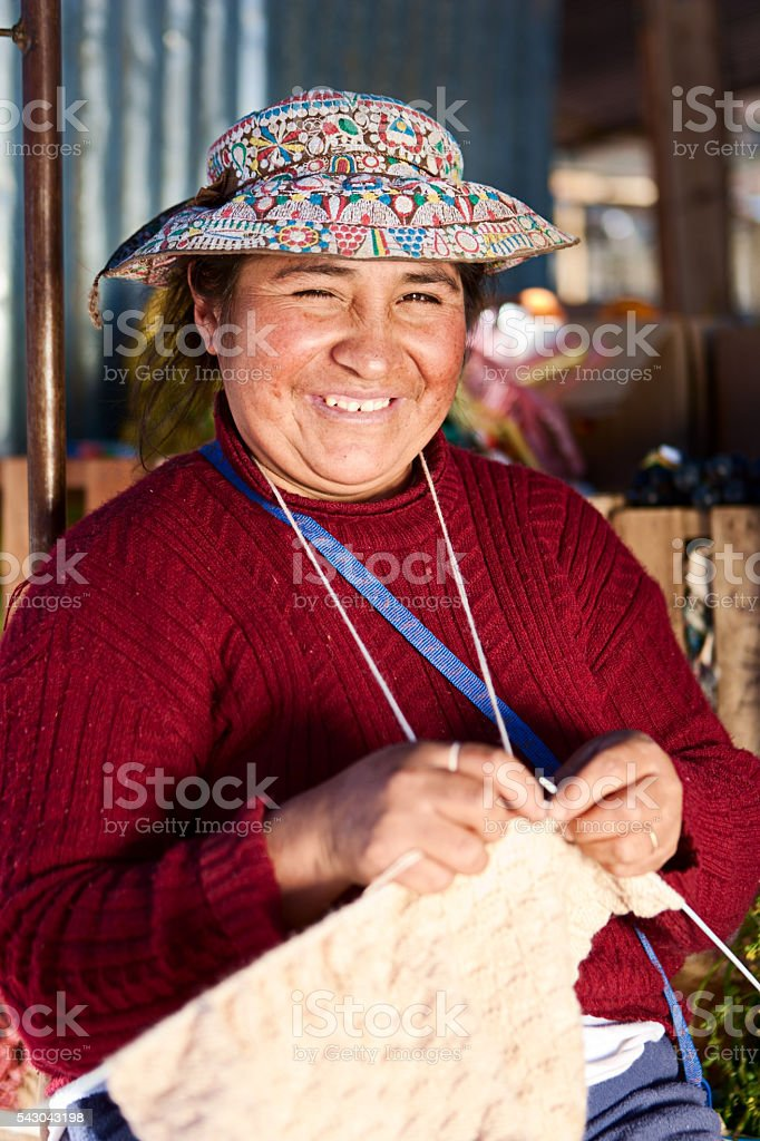 Peruvian woman in national clothing knitting in workshop, Chivay, Peru stock photo