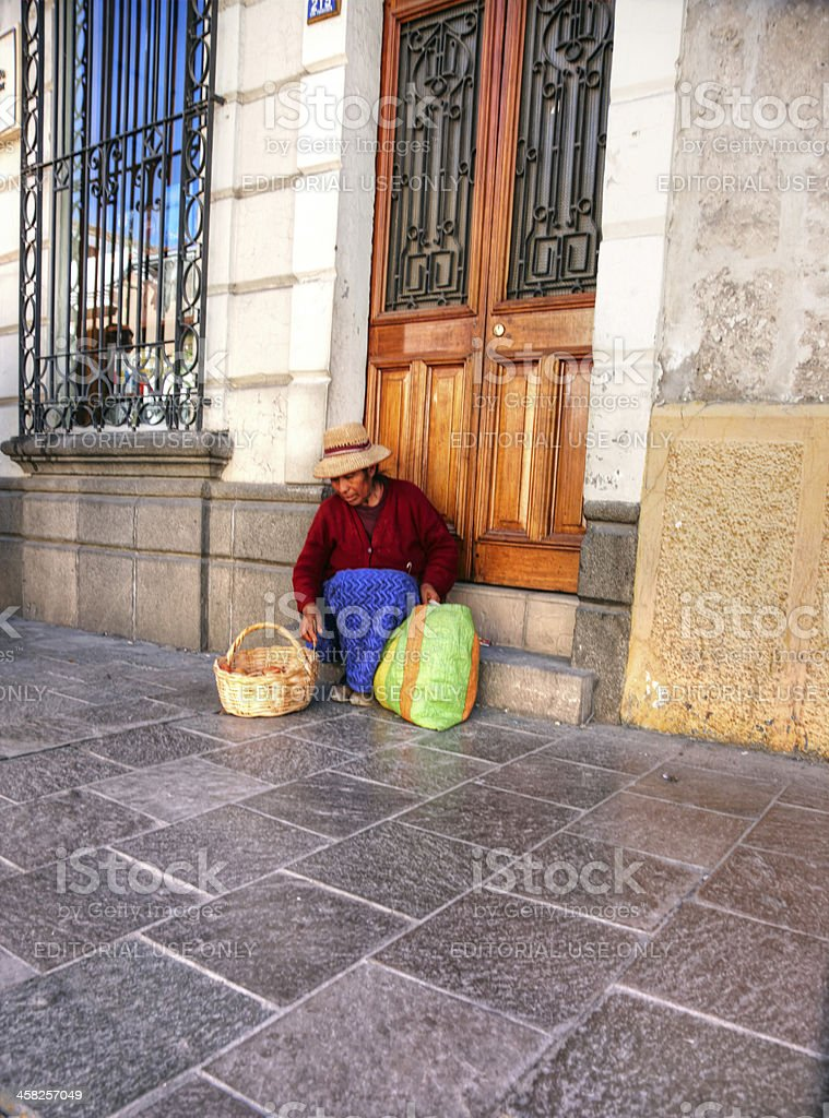 Peruvian woman in traditional dress selling on street royalty-free stock photo