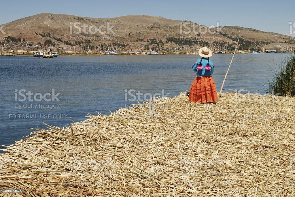 Peruvian Woman on Lake Titicaca royalty-free stock photo