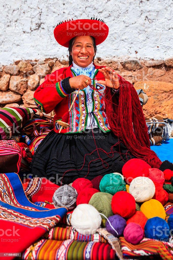 Peruvian woman selling souvenirs at Inca ruins, Sacred Valley, Peru royalty-free stock photo