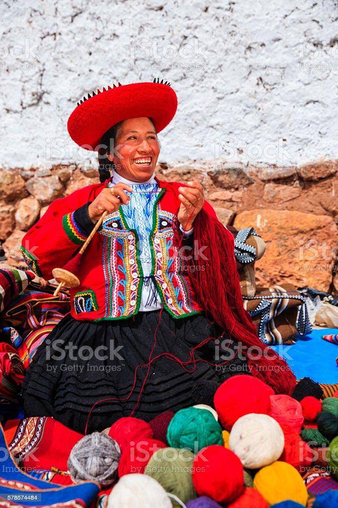 Peruvian woman selling souvenirs at Inca ruins, Sacred Valley, Peru stock photo