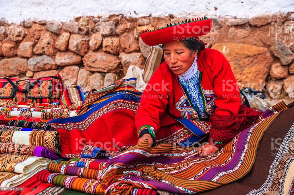 Peruvian woman selling souvenirs at Inca ruins, Sacred Valley, Peru stock photo