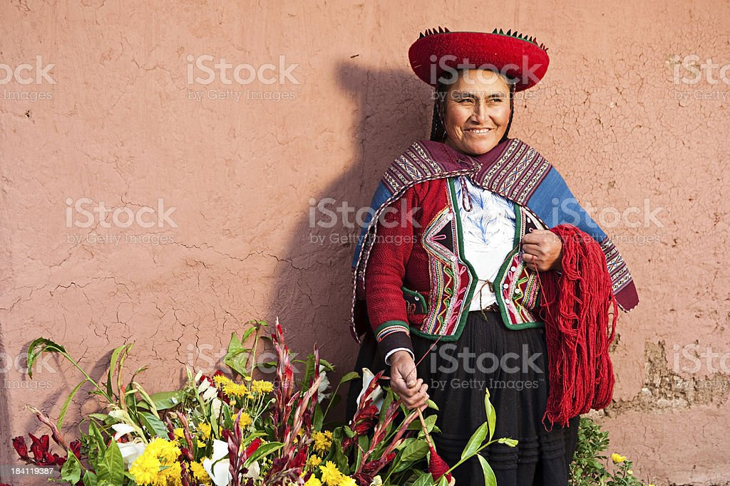 Peruvian woman spinning wool, The Sacred Valley, Chinchero stock photo