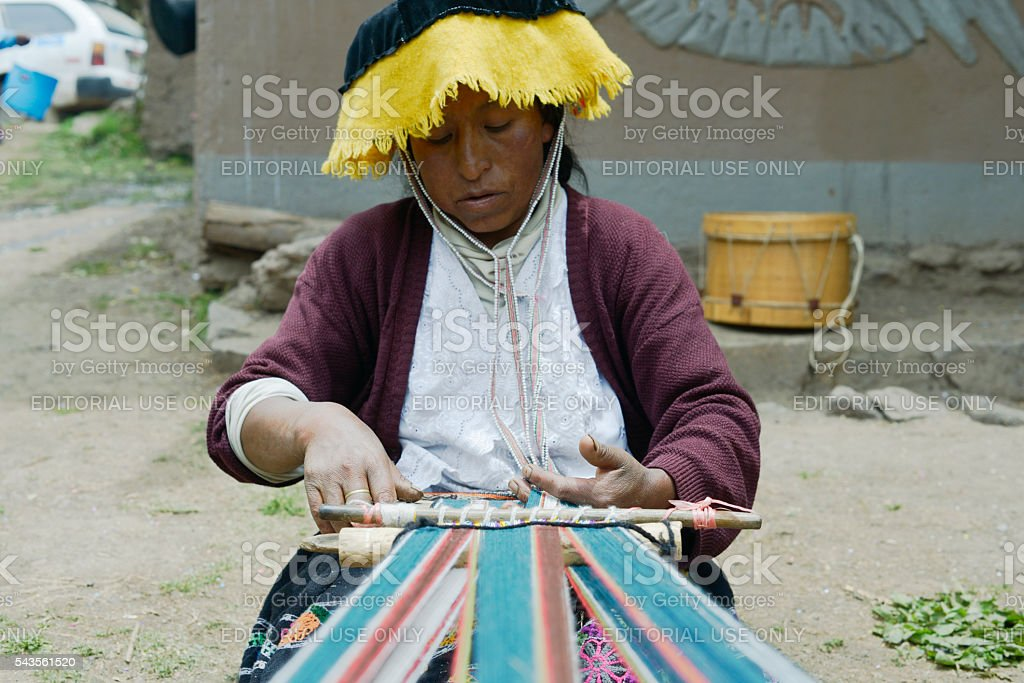 Peruvian woman weaving cloth on a hand loom stock photo