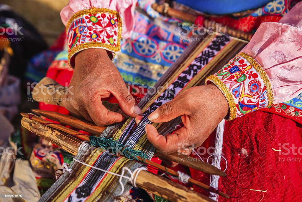 Peruvian woman weaving near Colca Canyon, Peru royalty-free stock photo
