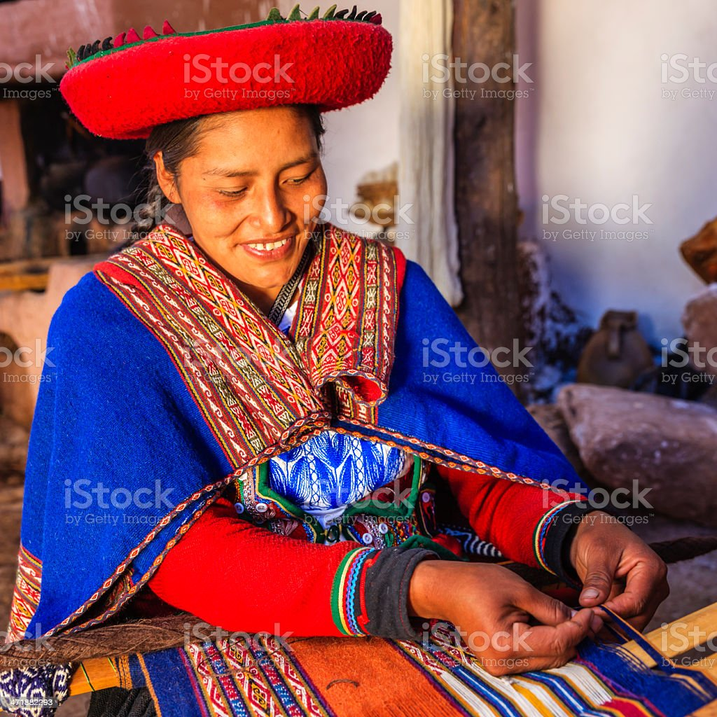 Peruvian woman weaving, The Sacred Valley, Chinchero royalty-free stock photo