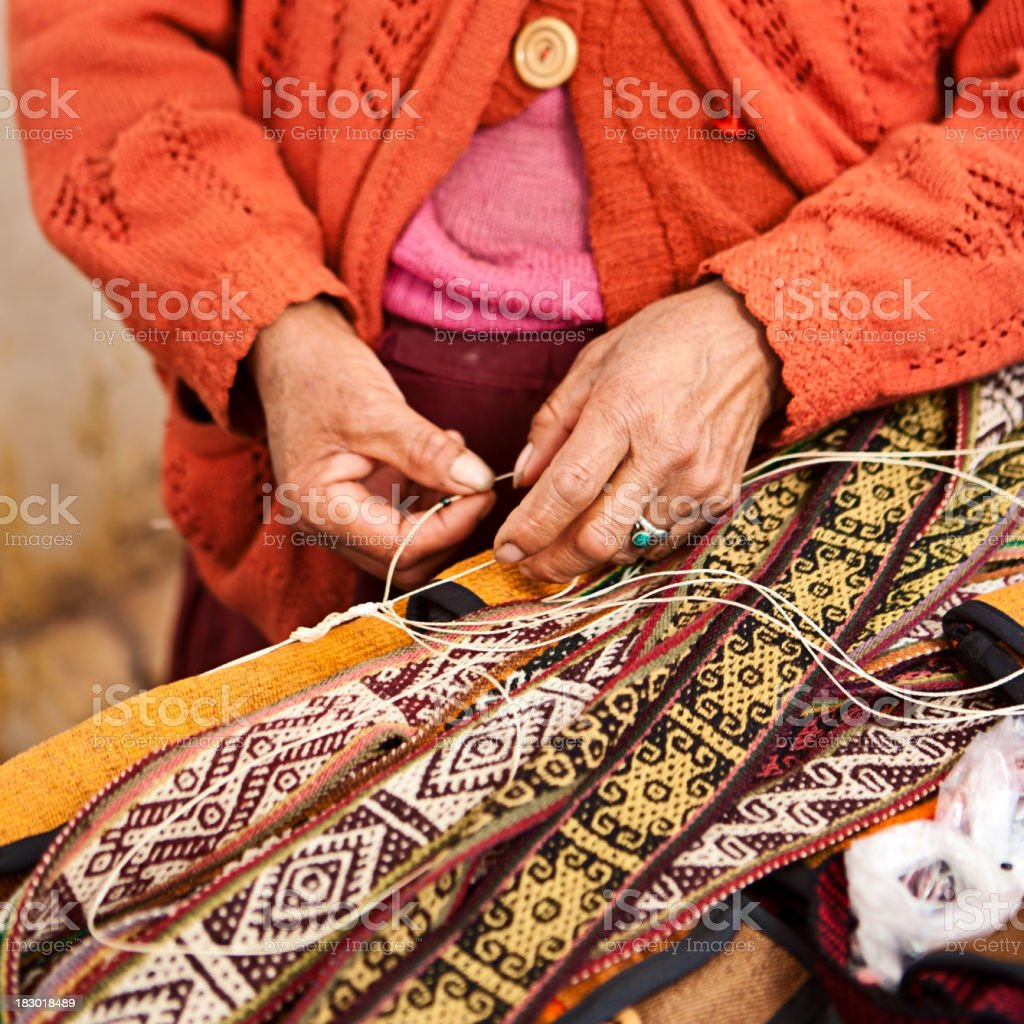 Peruvian woman weaving, The Sacred Valley, Pisac stock photo