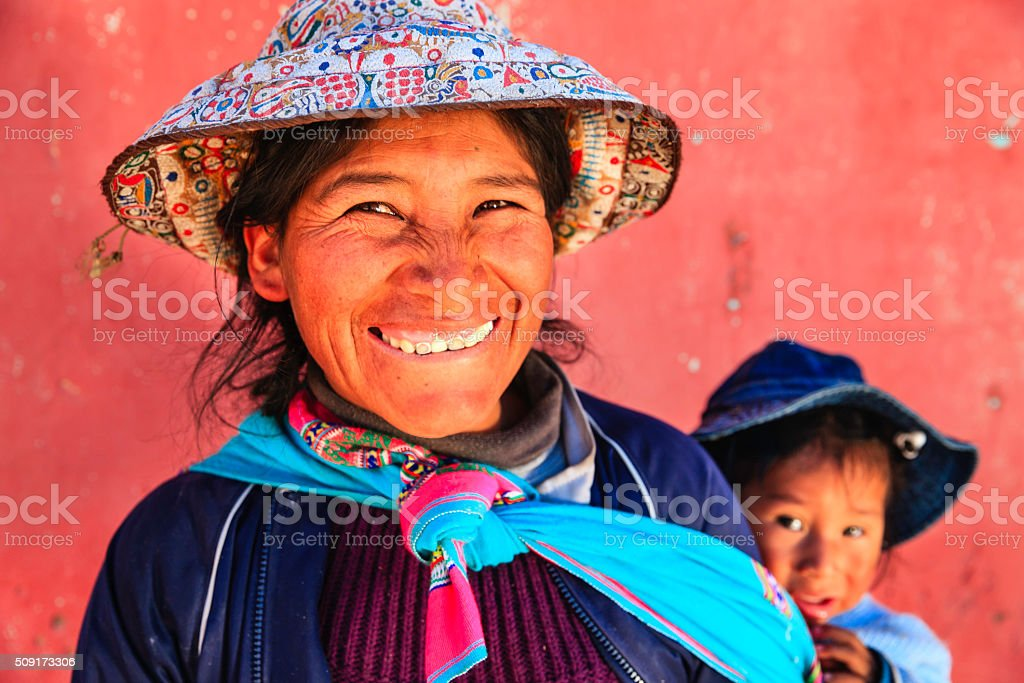 Peruvian woman with her baby on the back near Arequipa stock photo