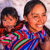 Peruvian woman with her baby on the back near Cuzco