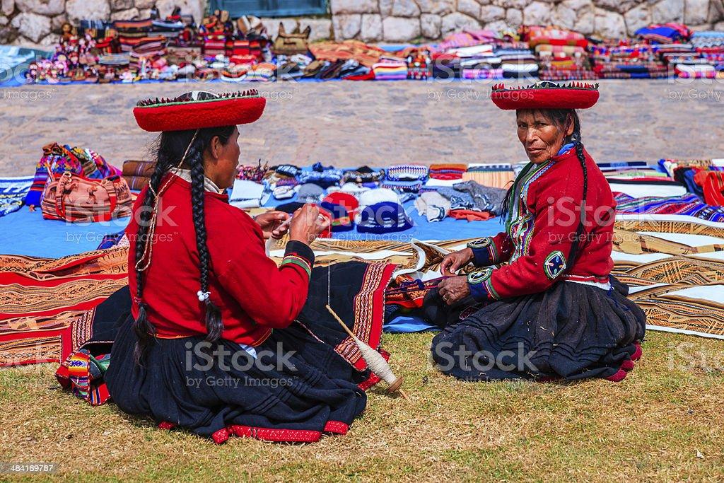 Peruvian women selling souvenirs at Inca ruins, Sacred Valley, Peru stock photo