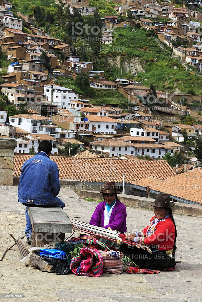 Peruvian Women Weaving Blankets stock photo
