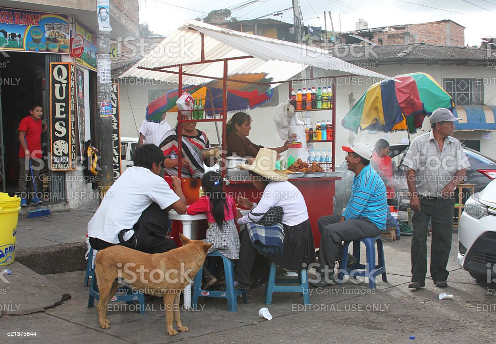 Peruvians Eating at Fried Chicken Kiosk stock photo