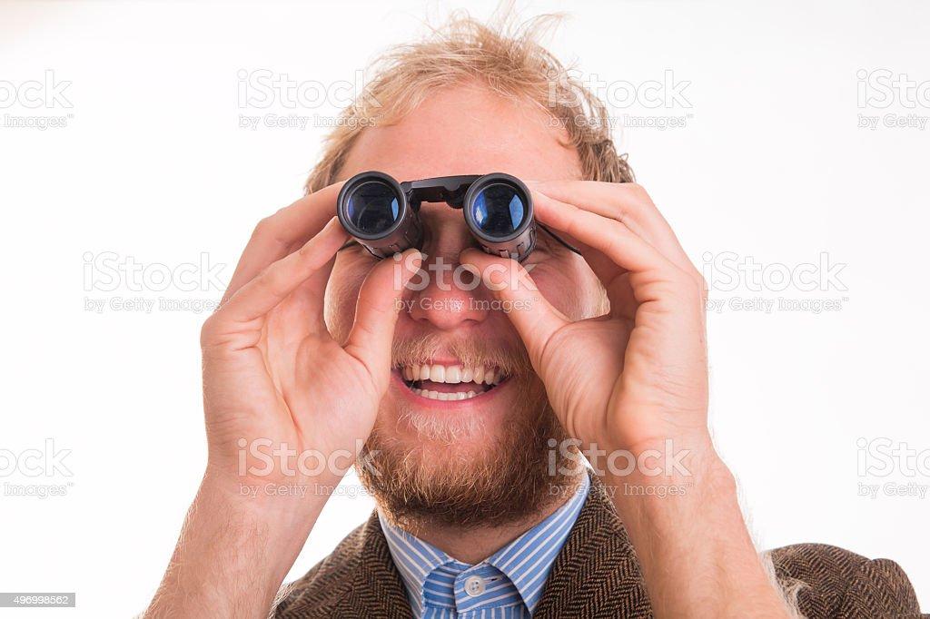 Pervert man watching through binoculars stock photo