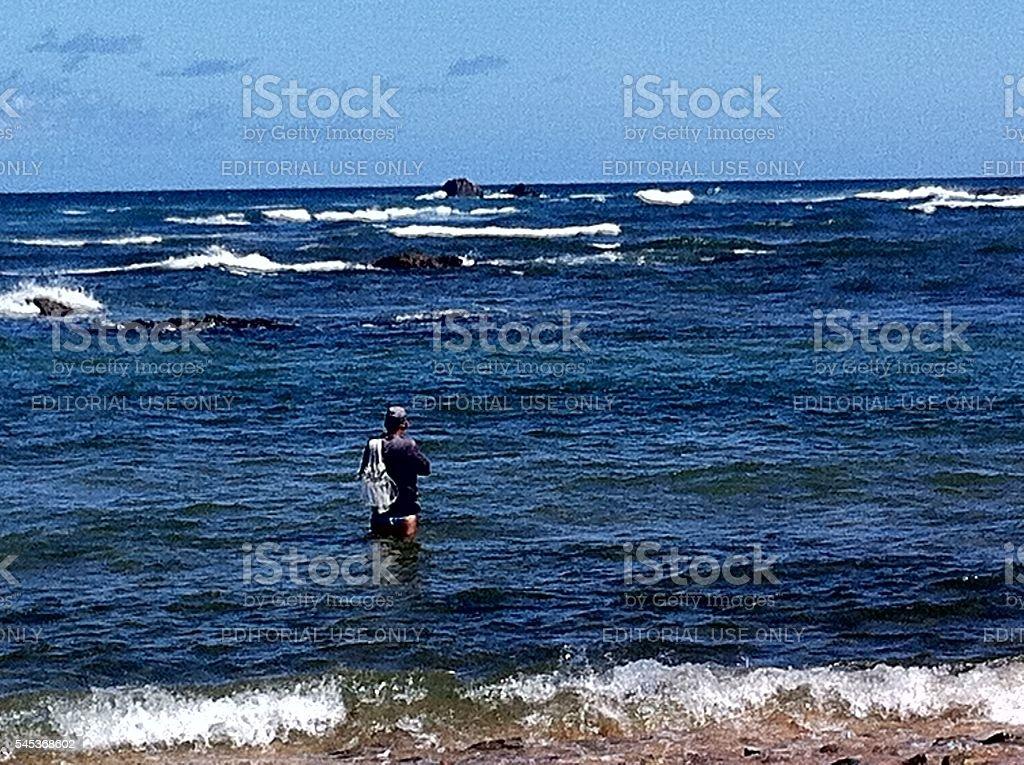 Pescador no mar da Bahia stock photo