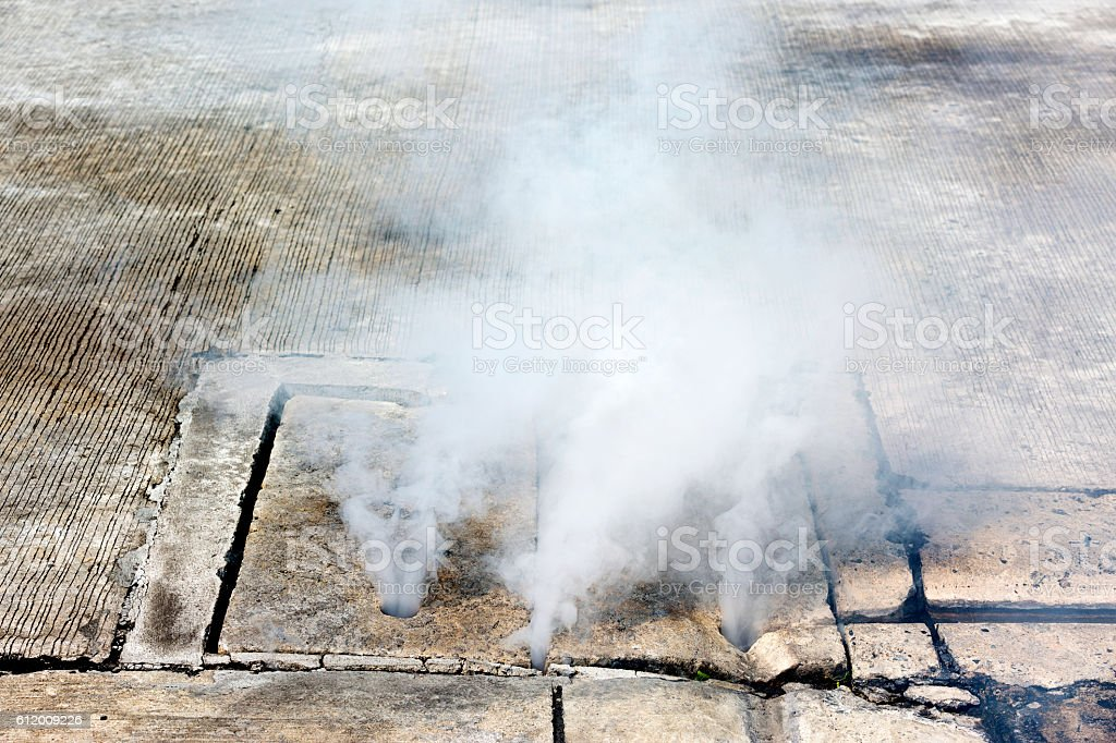Pest control smoke come out from manhole stock photo