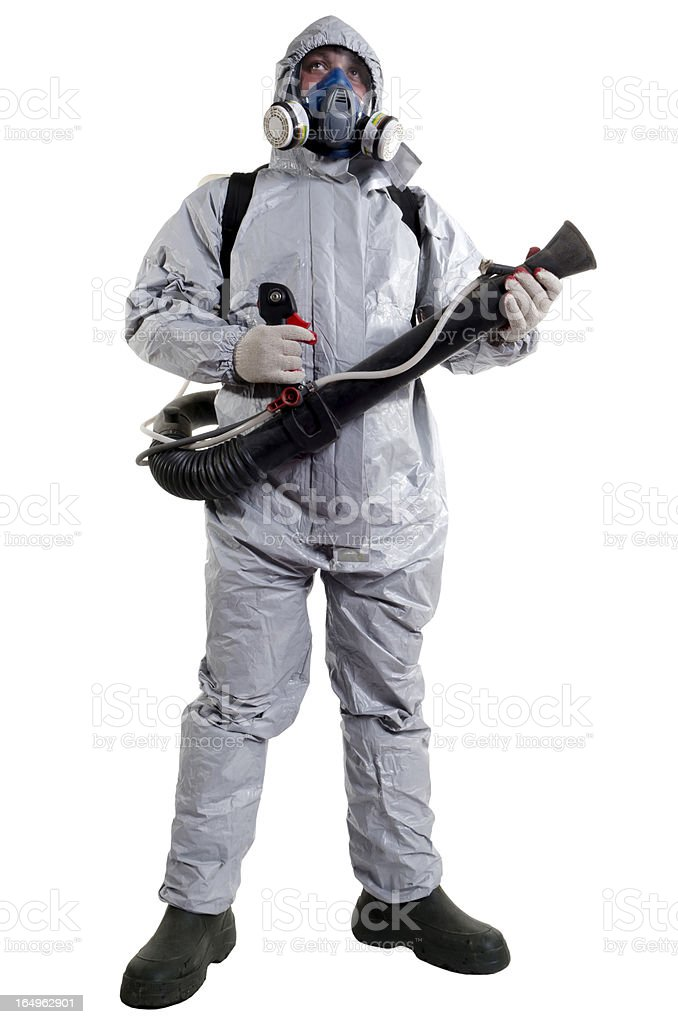 Pest control worker with s mask on and jumpsuit stock photo