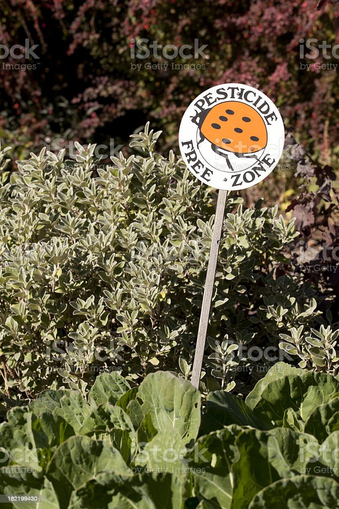 Pesticide Free Zone Sign in Garden royalty-free stock photo