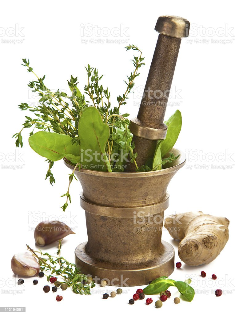 A pestle and mortar full of herbs and spices  royalty-free stock photo