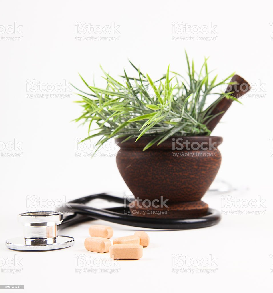 A pestle and mortar with herbs and medications royalty-free stock photo