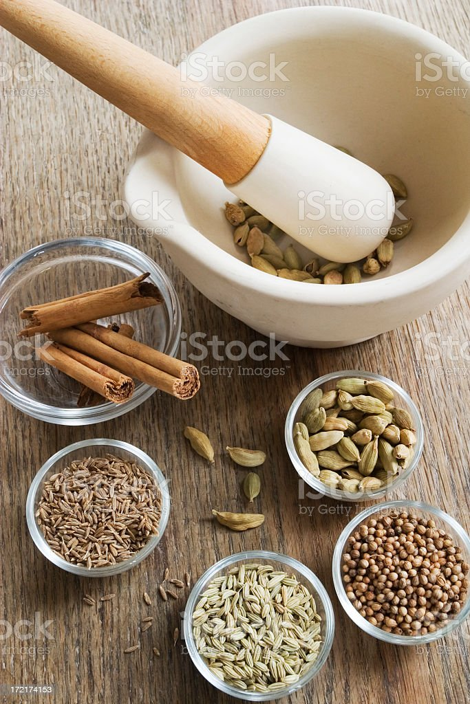 Pestle & Mortar with spices. stock photo