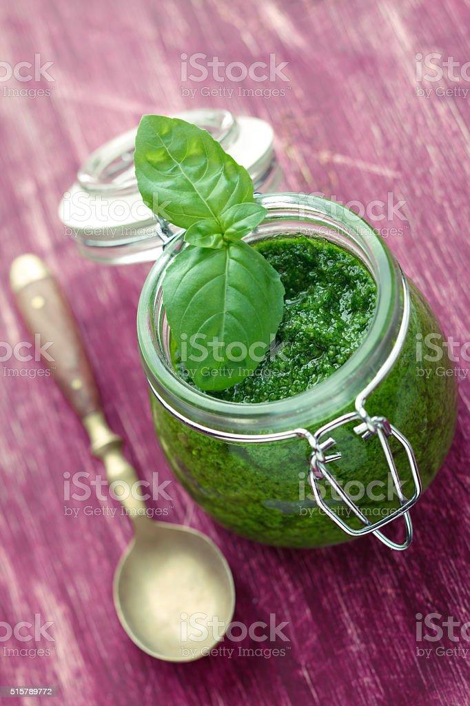Pesto in glass jar stock photo