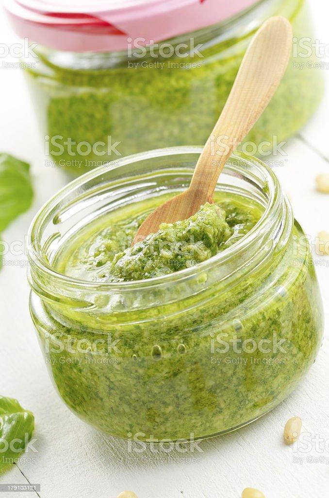 Pesto sauce and spoon royalty-free stock photo