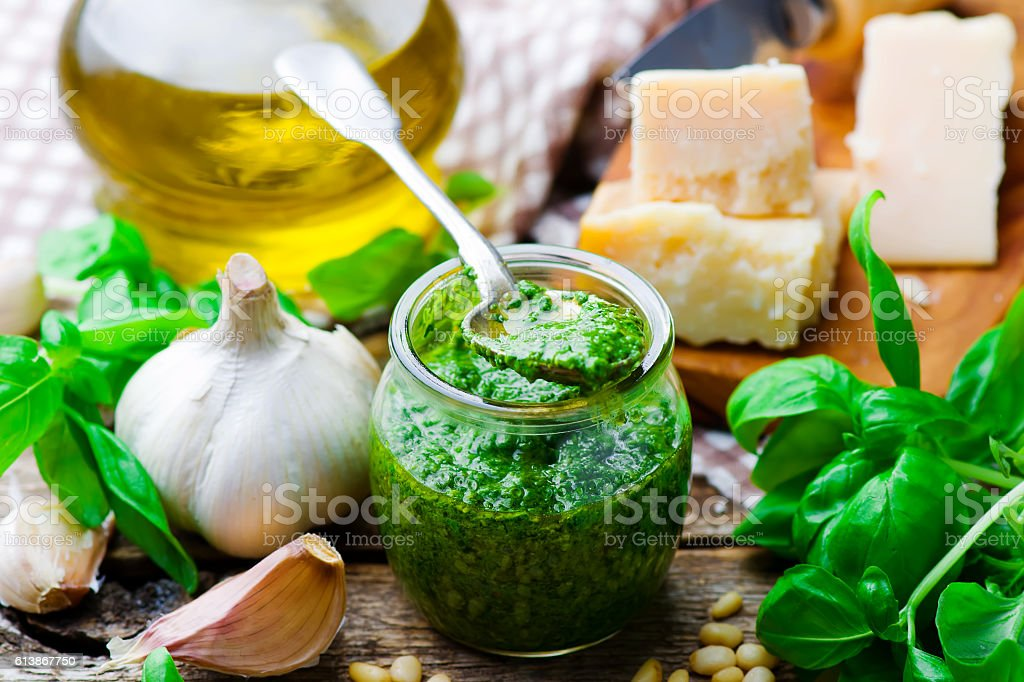 pesto sauce in a glass jar stock photo
