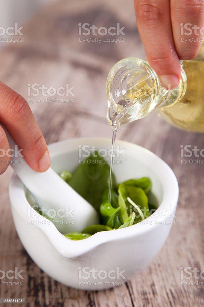 Pesto sauce preparation stock photo