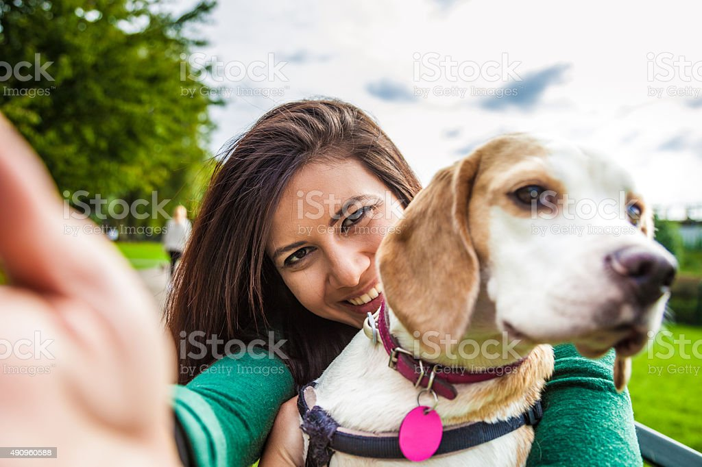 Pet owner and her dog taking a selfie stock photo