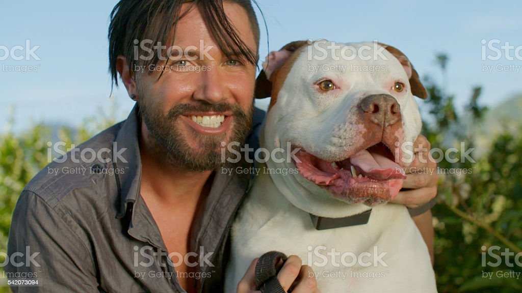 Pet Owner Kisses His Dog stock photo