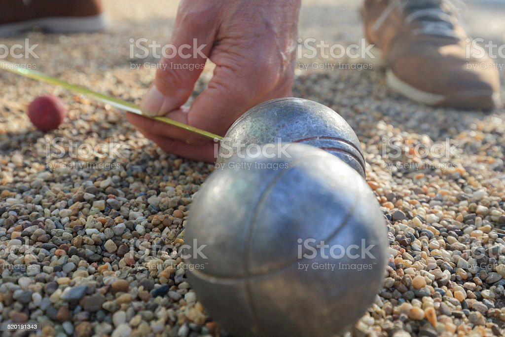 petanque balls and a small red jack stock photo
