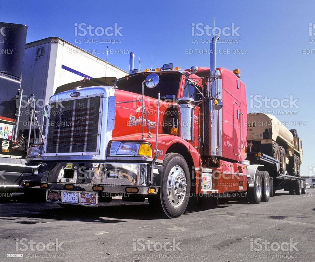 Peterbilt semi-truck and trailer in parking lot royalty-free stock photo
