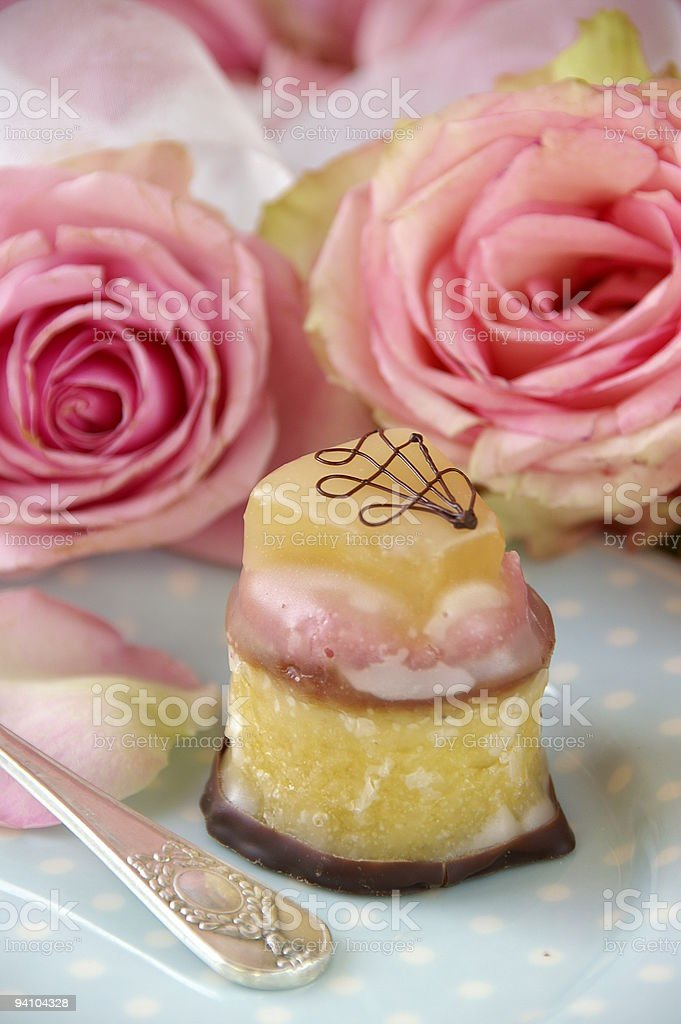Petit four and roses royalty-free stock photo
