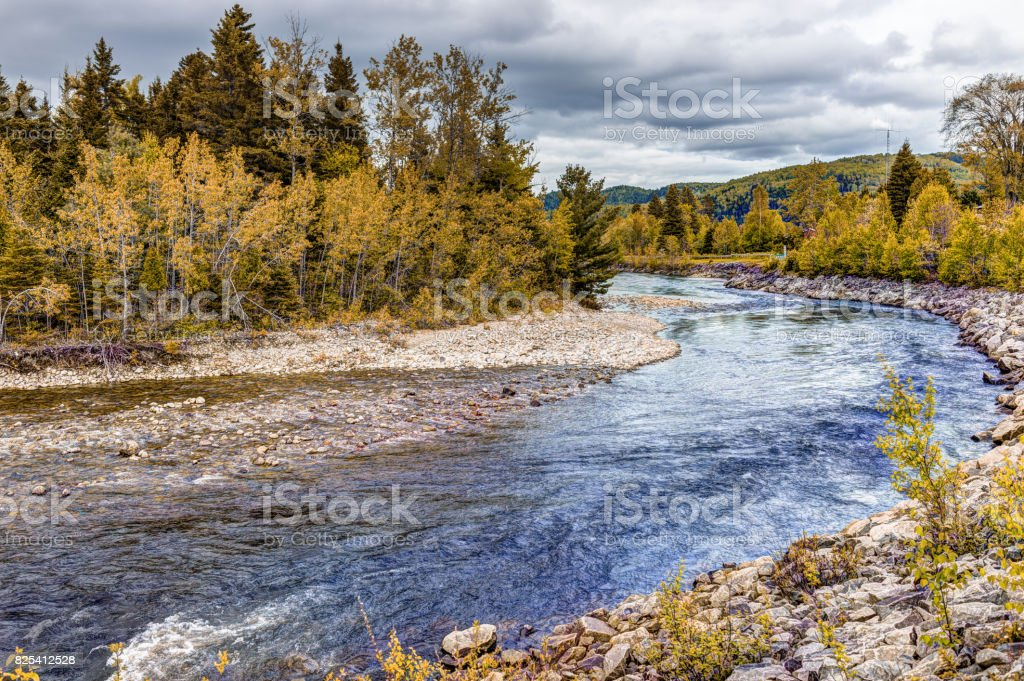 Petit Saguenay river in Quebec, Canada during autumn with curve stock photo