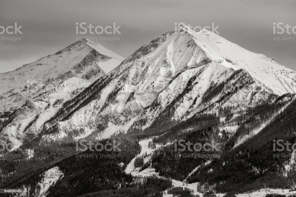 Petite and Grande Autane peaks in winter, Alps, France stock photo