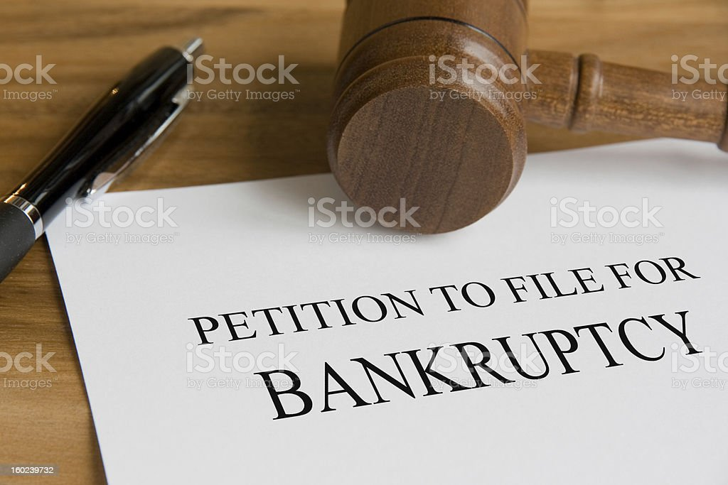 A petition to file for bankruptcy note stock photo