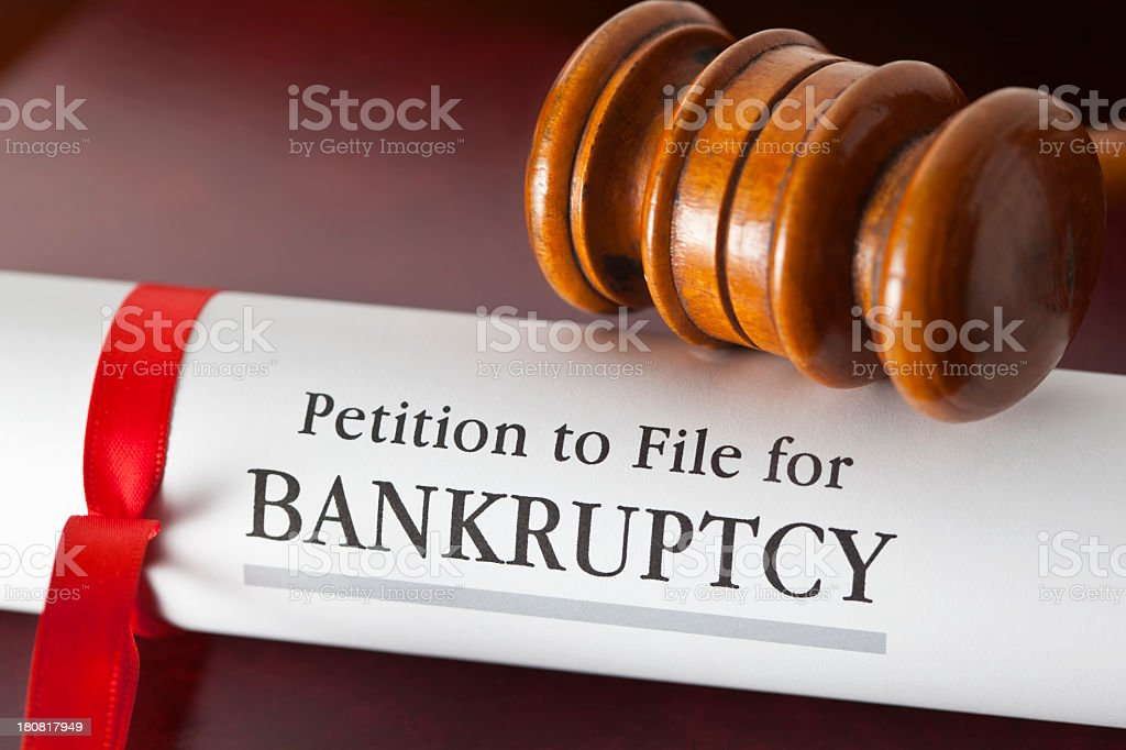 Petition to file for bankruptcy under a gavel stock photo