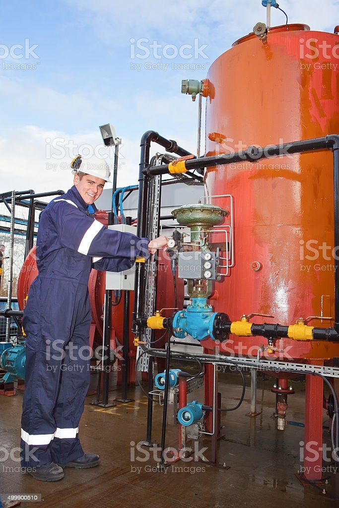 Petrochemical contractor posingl in front of an oil refinery stock photo