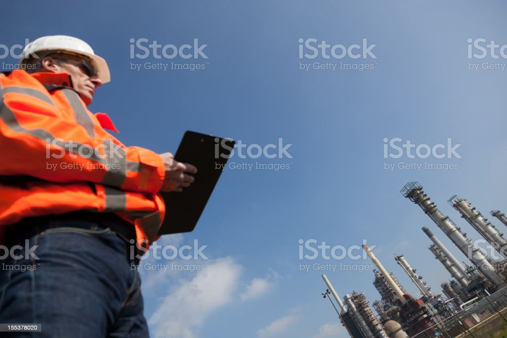 Petrochemical industry with inspector royalty-free stock photo