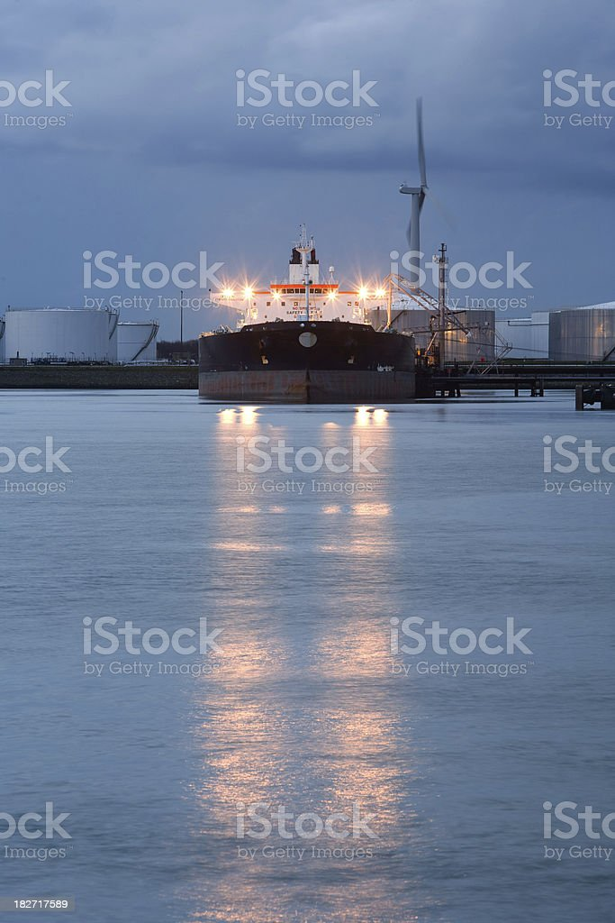 Petrochemical industry with super tanker by night stock photo
