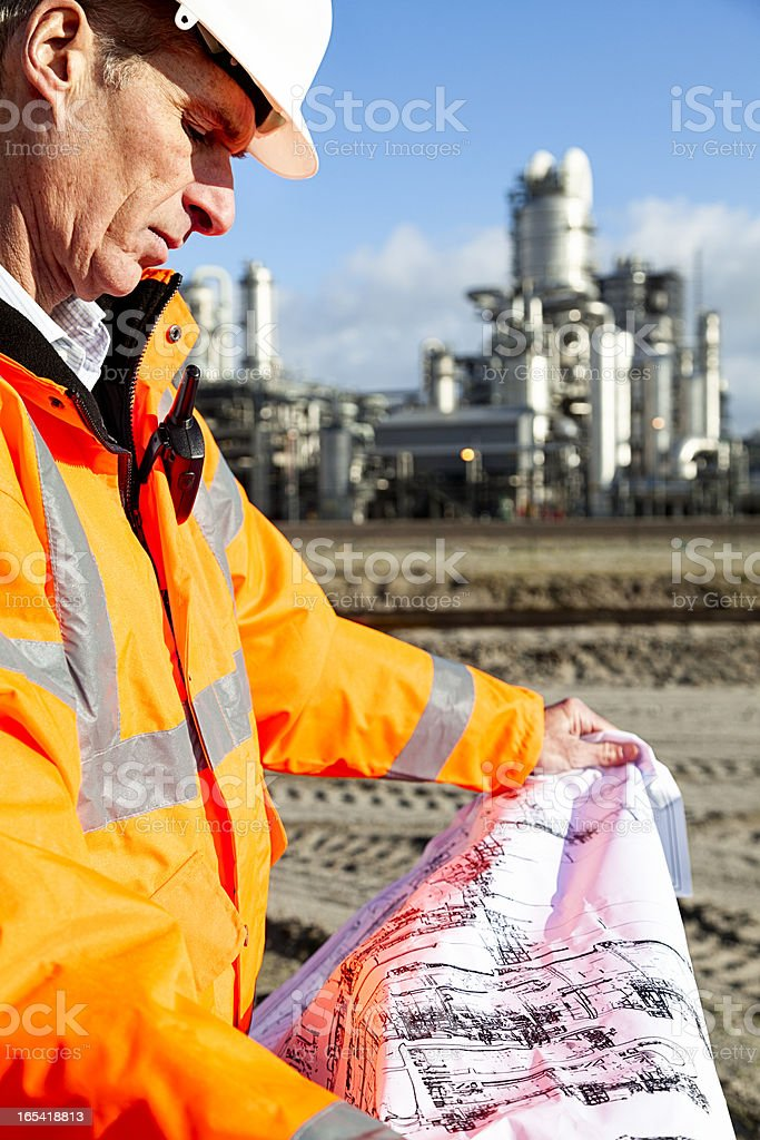 Petrochemical inspector with drawing royalty-free stock photo