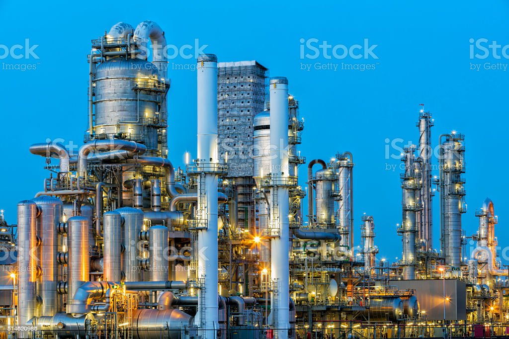 Petrochemical Plant Illuminated at Dusk stock photo