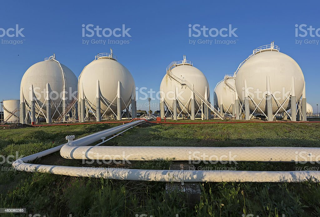 Petrochemical Plant pipeline and storage tanks stock photo