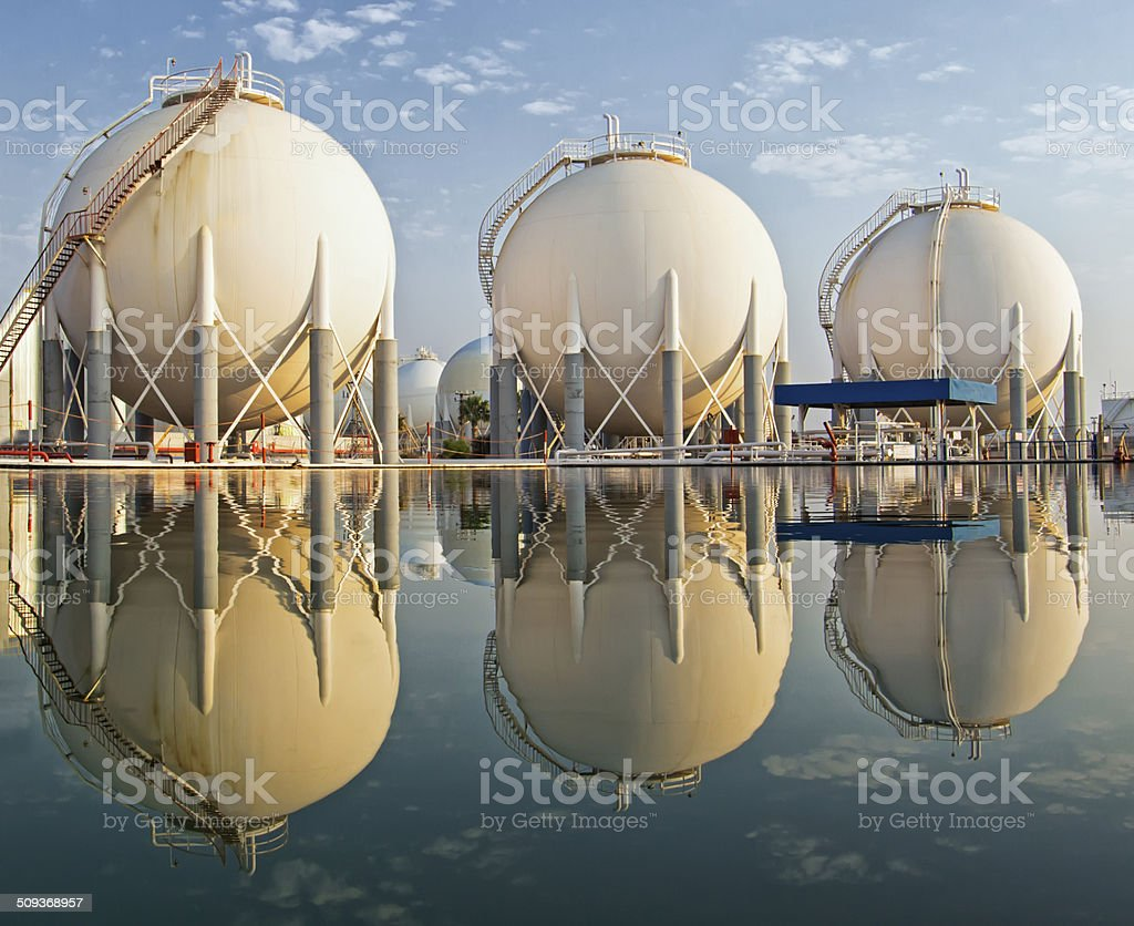Petrochemical tanks at refinery stock photo