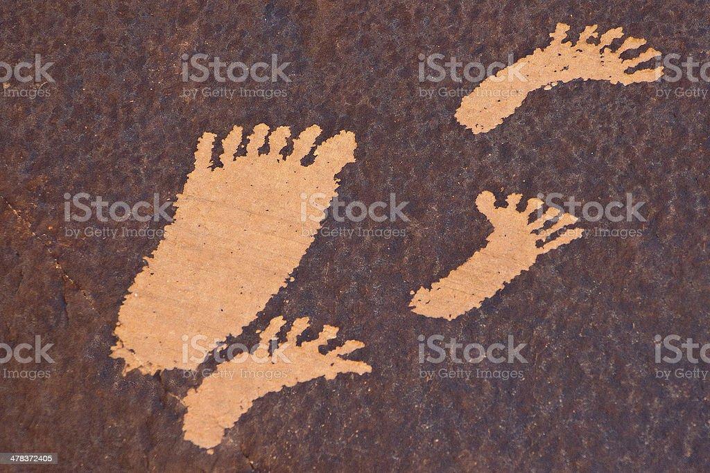Petroglyph Feet stock photo